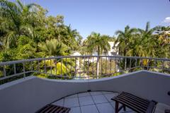 Private Balcony with glimpses of Palm Cove Beach past the tropical Palm Trees