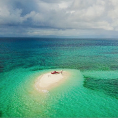 Private Sand Cay Helicopter Flight & Snorkel Tour