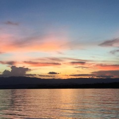 Private Sunset Cruise Port Douglas | Stunning Colours As The Sun Sets Over The Daintree Rainforest Range