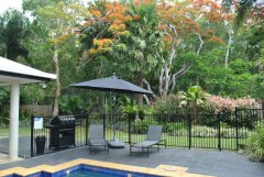 Relax by the pool in tropical surrounds in your private Palm Cove Holiday Home