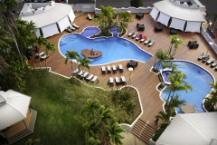 Relax in the Swimming Pool on Level 5 with City Views and Spas - Pullman Cairns International Hotel