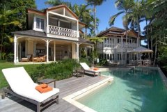 Relax on a sunbed by your heated private swimming pool - Luxury Port Douglas Holiday Home