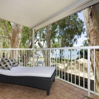 Relax on your Day Bed overlooking Palm Cove from your Beachfront Balcony - Paradise on the Beach Palm Cove