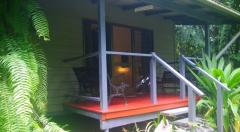 Relax on your own balcony at Heritage Lodge Spa Daintree