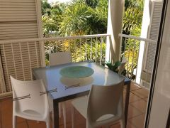 Relax on your private balcony in and adult only resort