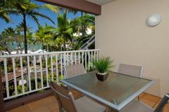 Relax on your private balcony with ocean views and tropical atmosphere - Coral Sands Resort