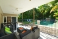 Relax poolside in this Port Douglas holiday home