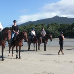 Riding Horses on the Beach at Cape Tribualtion