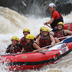 Riding the white water rafting rapids in Cairns Barron River