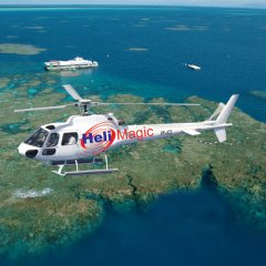 Scenic helicopter flight over Reef Magic pontoon