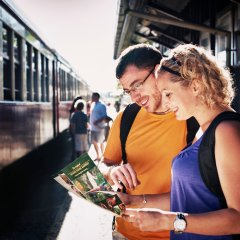 Couple with Kuranda Brochure at Cairns Train Station
