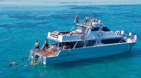Scuba diving off the back of the boat - hydraulic platform eases you to the water level