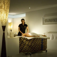 Sea Temple Resort therapist massaging a guest