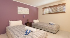 Second Bedroom with 2 Single Beds at Red Cowrie Apartment - Palm Cove