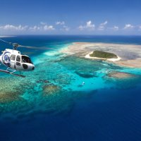 See Australia's Great Barrier Reef from the seat of your helicopter in Cairns Queensland Australia