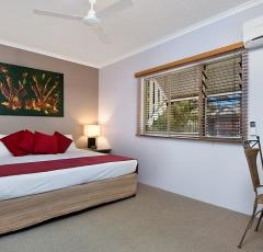 Separate spacious bedroom in your One Bedroom Apartment at Cairns Beach Resort