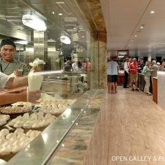 Showcase galley with viewing window creating fresh cuisine featuring Australian and local produce.