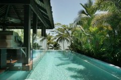 Side view of infinity edge swimming pool on Port Douglas holiday home