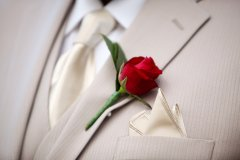 Single button hole rose for a groom at Port Douglas wedding