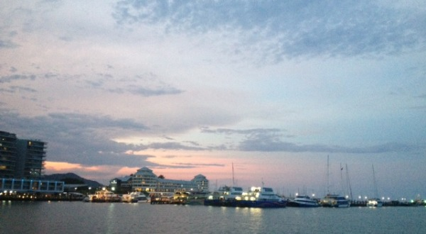 Sip wine and watch the sunset on the Cairns Harbour Cruise