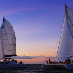 Our Luxury Sister Catamarans Sailing at Sunset to Port Douglas
