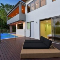 Sit back and relax by holiday homes heated swimming pool