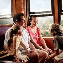 Sit in comfortable historic carriages on the Kuranda Scenic Railway train