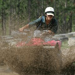 Slide in the mud on our ATV and quad bike tours in Cairns