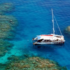 Small boat touring on Australia's Great Barrier Reef