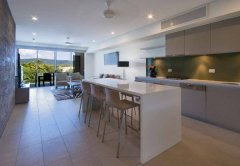 Spacious Kitchen and Living Area - Balcony Apartment - Luxury Holiday Apartments Port Douglas