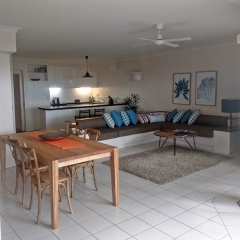 Spacious living and dining area opening out to ground floor patio and Palm Cove Beach