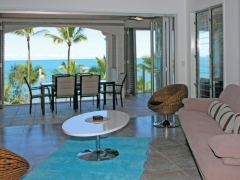 Spacious Living Area with Ocean Views at Island Views Luxury Apartments
