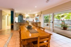Spacious living opens out to Pool Area - Palm Cove Holiday Home