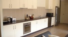 Spacious open plan kitchen with modern appliances - Palm Cove Holiday Villa