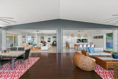 Spacious open plan living flowing out to the expansive deck | Cairns Luxury Holiday Home