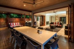 Spacious outdoor dining & BBQ facilities overlooking the Pool -  Palm Cove Holiday House