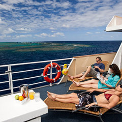 Sun deck relaxation area on liveaboard dive boat Great Barrier Reef