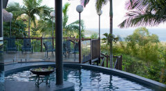 Swim in a pool with views to the Coral Sea and Cairns