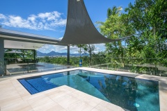 Swim in the resort style swimming pool in your private holiday house overlooking Cairns