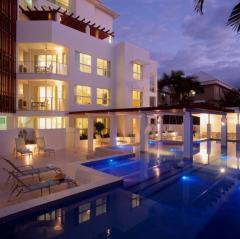 Swimming pool at dusk at 201 Lake St Holiday Apartments Cairns