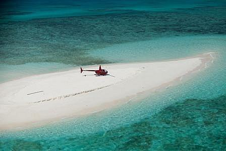Take a scenic helicopter flight to a solitary sand cay on the Great Barrier Reef from Cairns