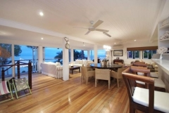 Take in the stunning ocean views from the open plan Kitchen, Dining and upstairs living areas - Luxury Wharf St Holiday House Port Douglas