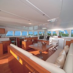 The interior saloon is spacious and comfortable on this luxury catamaran tour to the Great Barrier Reef