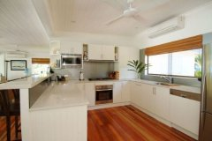 The Port Douglas Holiday House has Large Kitchen with modern appliances, and plumbed in fridge