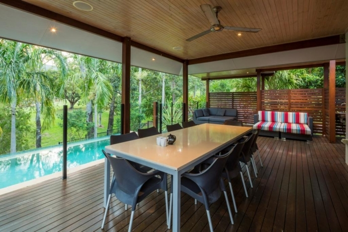 Enjoy spacious outdoor dining overlooking the pool | Palm Cove Holiday Home