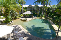 Enjoy the outdoor swimming pool, spa and BBQ facilities amongst tropical gardens at Port Douglas Sands Resort