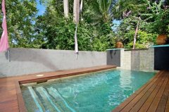 Enjoy relaxing in your private Spa or dip in your private Swimming pool - Celadon Palm Cove Holiday House