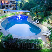 Tropical Swimming Pool with BBQ facilities and sun lounges