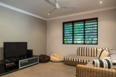 TV Room at Holiday House Palm Cove - for families