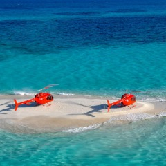 Two helicopters on a sand cay snorkel tour on the Great Barrier Reef